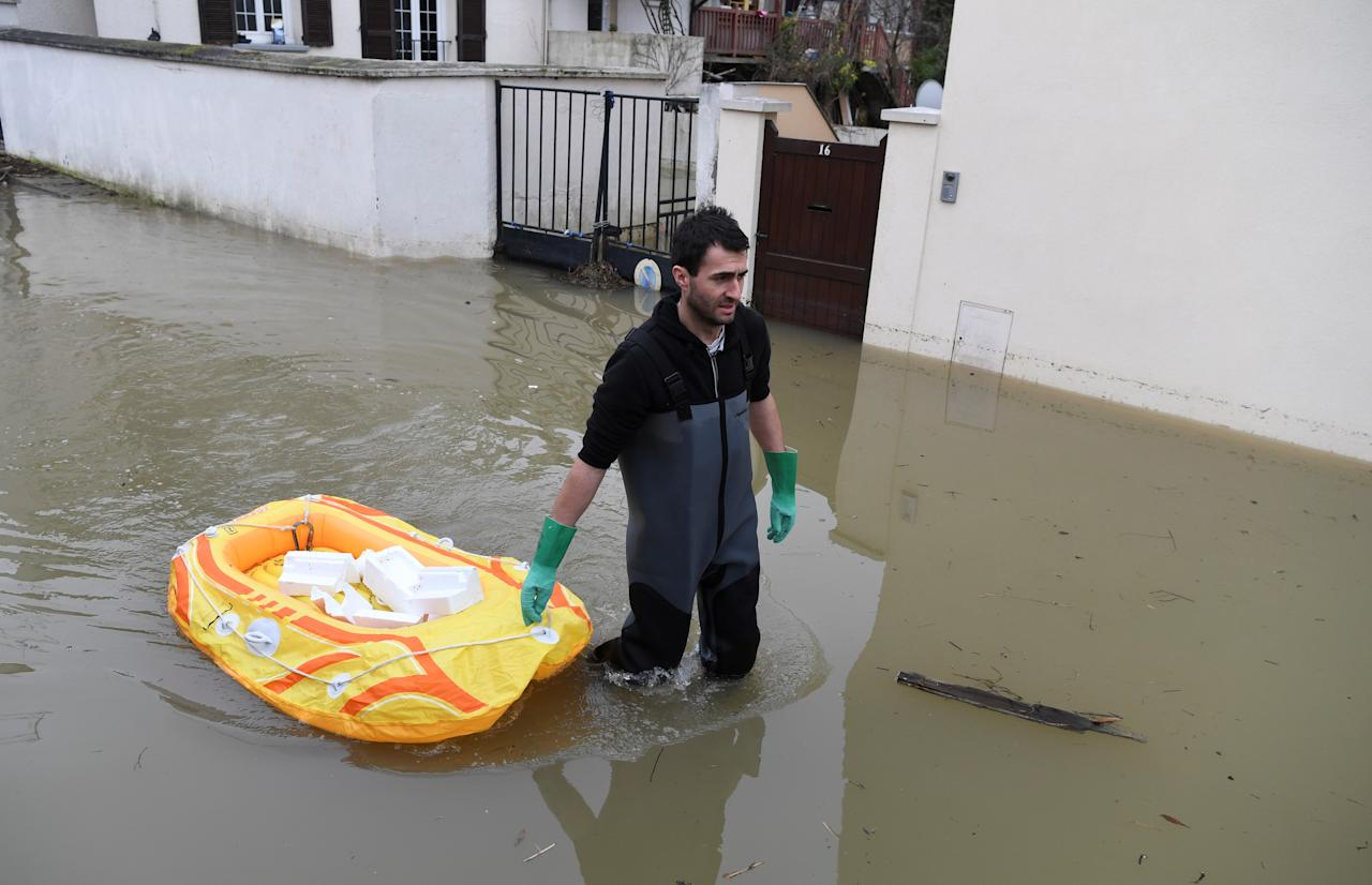 <p>A man walks in a flooded street on Jan. 30, 2018, in Villeneuve-le-Roi, near Paris. (Photo: Alain Jocard/AFP/Getty Images) </p>