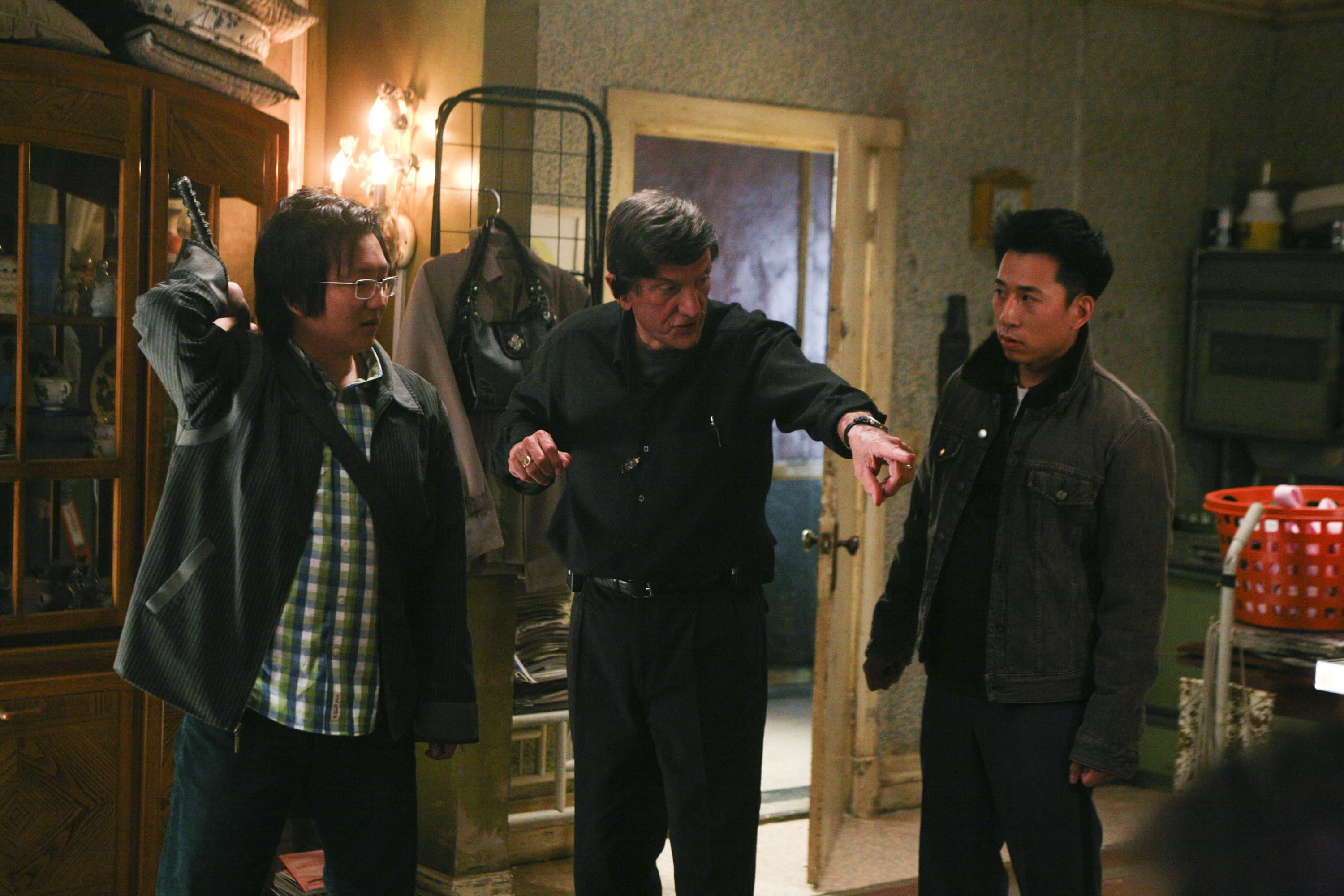 """HEROES -- """"The Hard Part"""" Episode 21 -- Aired 5/7/07 --Pictured: (l-r) Masi Oka as Hiro Nakamura, director John Badham, James Kyson Lee as Ando Masahashi (Photo by Dean Hendler/NBCU Photo Bank/NBCUniversal via Getty Images via Getty Images)"""