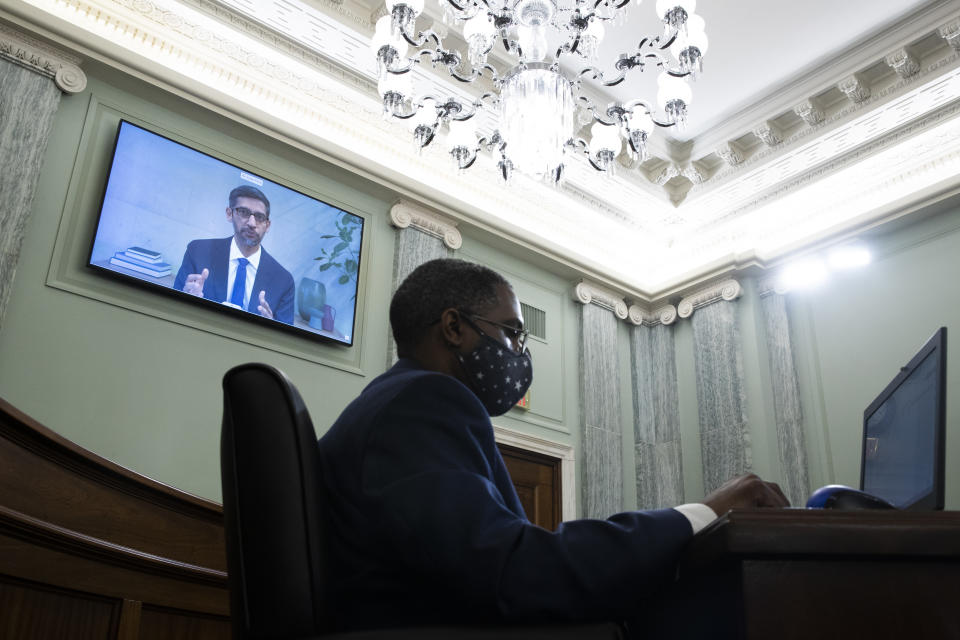 WASHINGTON, DC - OCTOBER 28: Sundar Pichai, CEO of Alphabet Inc. and its subsidiary Google LLC, appears on a monitor behind a stenographer as he remotely testifies during the Senate Commerce, Science, and Transportation Committee hearing: Tech Bad Behavior?  ', On Capitol Hill October 28, 2020 in Washington, DC.  Twitter CEO Jack Dorsey;  CEO of Alphabet Inc. and its subsidiary Google LLC, Sundar Pichai;  and Facebook CEO Mark Zuckerberg all gave a virtual testimony at the hearing.  Section 230 of the Communications Decency Act guarantees that technology companies cannot be sued for content on their platforms, but the Department of Justice has proposed restricting this legislation.  (Photo by Michael Reynolds-Pool / Getty Images)