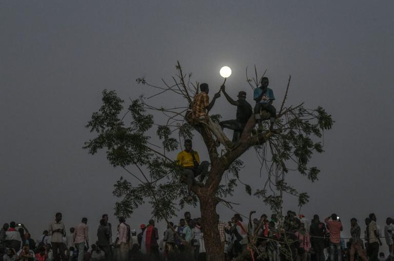 Sudanese protesters keep up a nightime vigil outside the army complex in the capital Khartoum