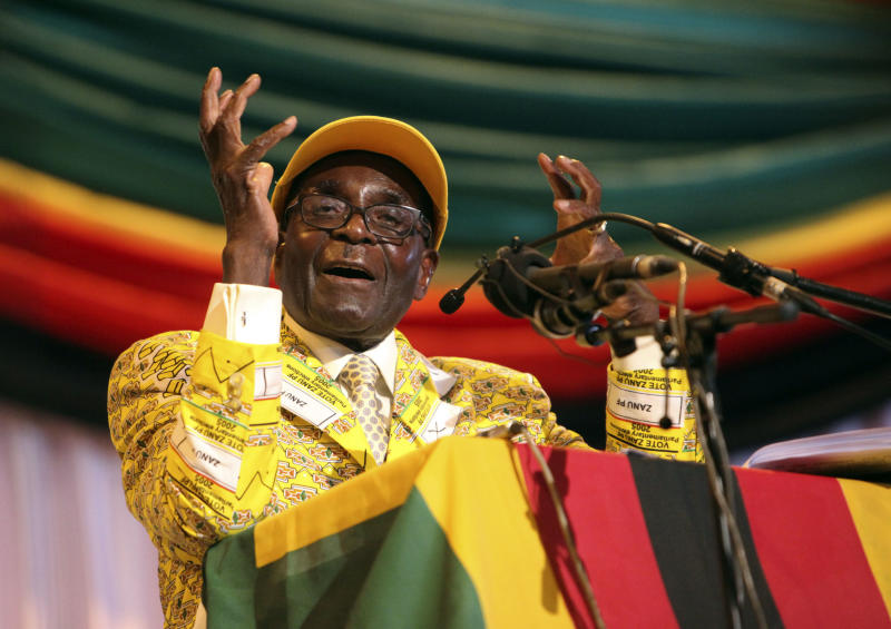"""Zimbabwean President Robert Mugabe delivers his speech at his party's 13th annual conference, in Gweru about 250 Kilometres south west of the capital Harare, Friday, Dec. 7, 2012. Zimbabwe president's loyalists have converged for an annual party convention in the provincial city of Gweru, hoping to map out a winning election strategy to end a conflict-ridden four-year-old coalition. President Robert Mugabe said in the state media Friday the convention should prepare for a convincing victory """"that will leave no room for doubt."""" The longtime leader has said he wants elections in March, a target that doesn't seem realistic. (AP Photo/Tsvangirayi Mukwazhi)"""