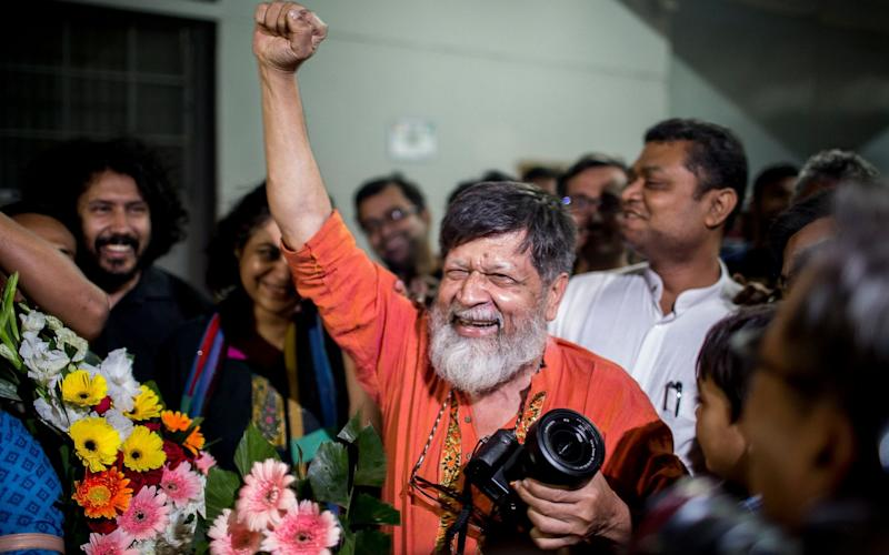 Bangladeshi photographer and activist Shahidul Alam reacts as he is released from Dhaka Central Jail - AFP