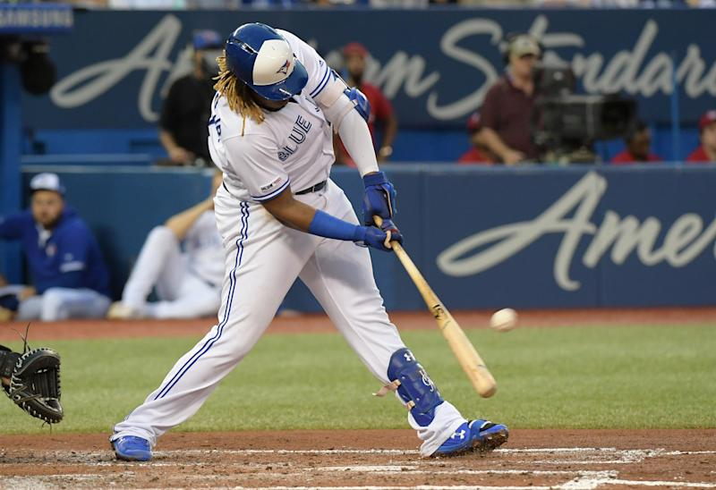 Aug 16, 2019; Toronto, Ontario, CAN; Toronto Blue Jays third baseman Vladimir Guerrero Jr. (27) hits a two run home run against Seattle Mariners in the third inning at Rogers Centre. Mandatory Credit: Dan Hamilton-USA TODAY Sports