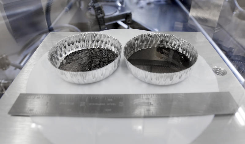 Two separate 2 inch foil pans hold lunar dirt, from the last shovel full collected by Neil Armstrong on the Apollo 11, in the lunar lab at the NASA Johnson Space Center Monday, June 17, 2019, in Houston. (Photo: Michael Wyke/AP)