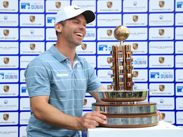 Paul Casey celebrates with the trophy after victory at the Green Eagle Golf Course: Getty
