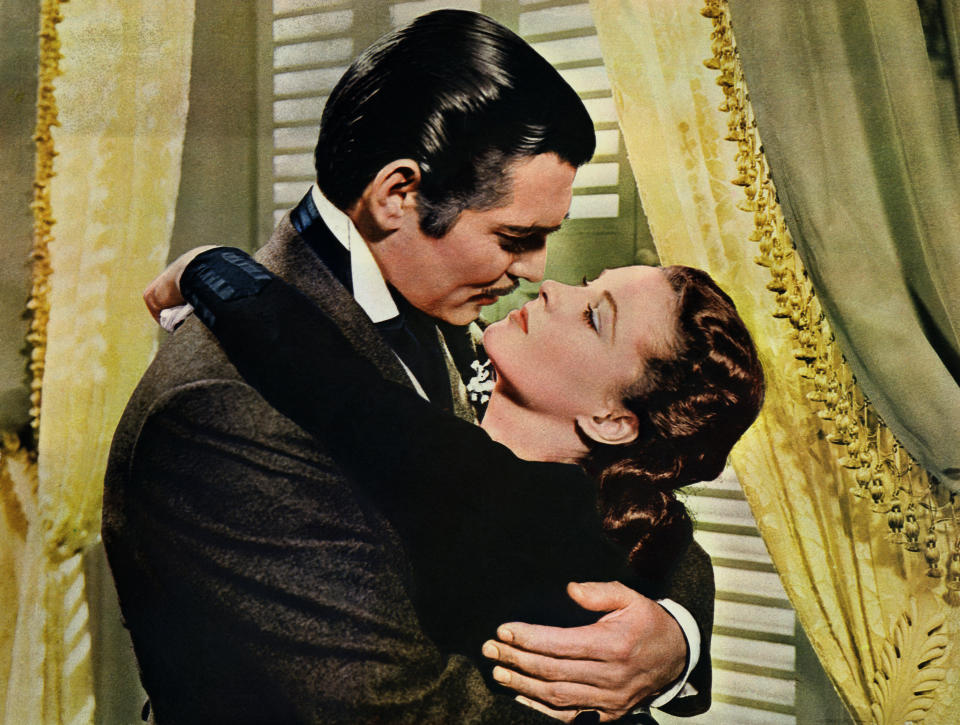 Rhett Butler (Clark Gable) embraces Scarlett O'Hara (Vivien Leigh) in a famous scene from the 1939 epic film Gone with the Wind.