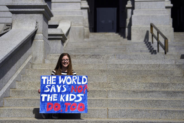 <p>Isabella Yow 16, sophomore at Cherry Creek High School makes one more picture as she joined students at the Denver State Capitol and schools across the nation with walkouts/gun violence protests on the one month anniversary of the Parkland, Florida shooting. March 14, 2018 Denver, Colorado. (Photo: Getty Images) </p>