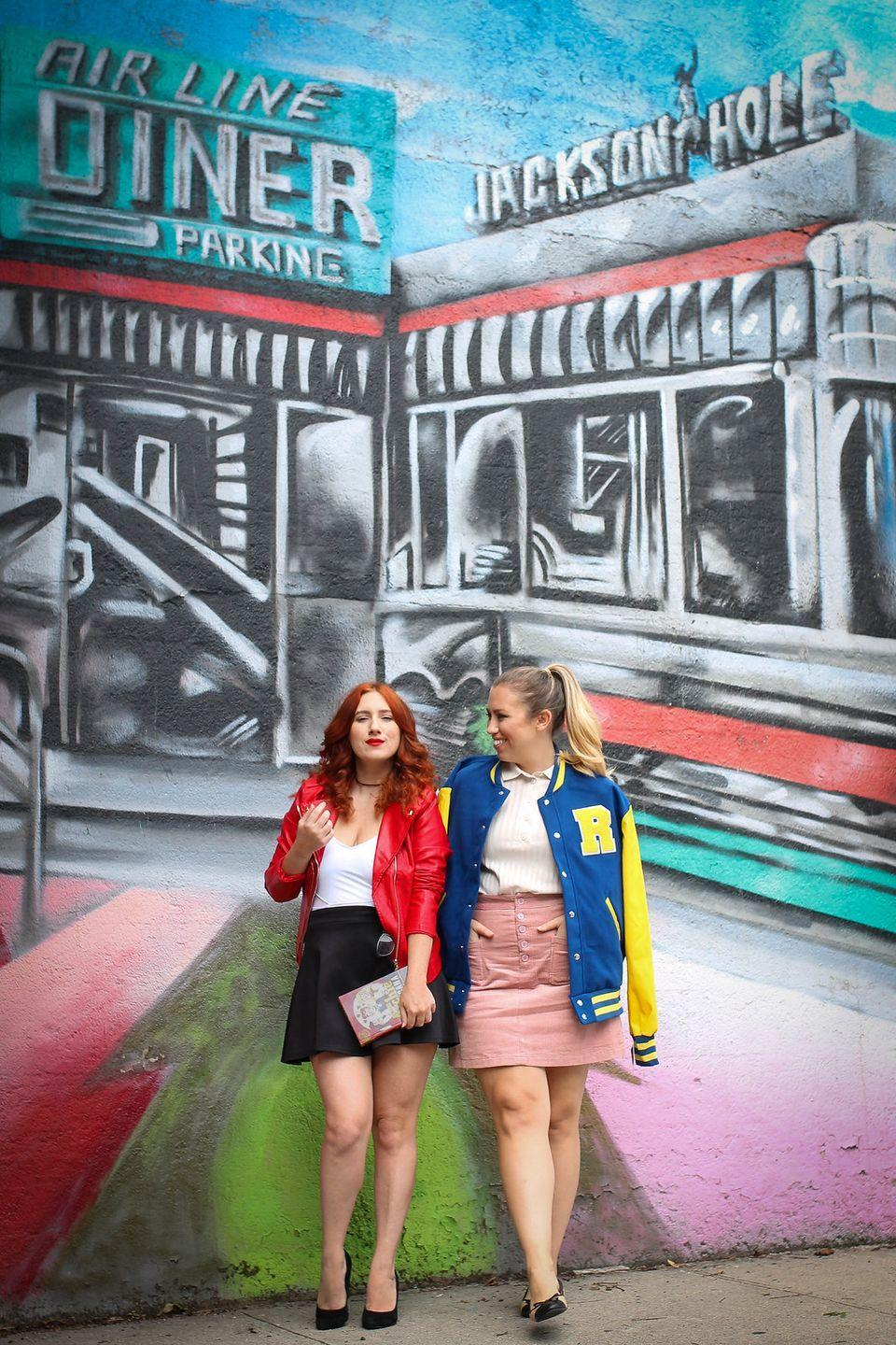 """<p>Since the halls of Riverdale High are typically buzzing about Betty and Cheryl's fashion, steal their style by wearing character-appropriate wigs (blonde for Betty, red for Cheryl) and jackets (old-school varsity for Betty, red leather for Cheryl). </p><p><a class=""""link rapid-noclick-resp"""" href=""""https://www.amazon.com/Tanming-Womens-Leather-Collar-X-Large/dp/B01GTF5OOG/?tag=syn-yahoo-20&ascsubtag=%5Bartid%7C10055.g.29516206%5Bsrc%7Cyahoo-us"""" rel=""""nofollow noopener"""" target=""""_blank"""" data-ylk=""""slk:SHOP RED JACKETS"""">SHOP RED JACKETS</a></p><p><a class=""""link rapid-noclick-resp"""" href=""""https://www.amazon.com/Rubies-Riverdale-Deluxe-Andrews-Standard/dp/B07D6TWFSF/?tag=syn-yahoo-20&ascsubtag=%5Bartid%7C10055.g.29516206%5Bsrc%7Cyahoo-us"""" rel=""""nofollow noopener"""" target=""""_blank"""" data-ylk=""""slk:SHOP VARSITY JACKETS"""">SHOP VARSITY JACKETS</a></p><p><em><a href=""""http://livingaftermidnite.com/2018/10/easy-riverdale-halloween-costumes.html"""" rel=""""nofollow noopener"""" target=""""_blank"""" data-ylk=""""slk:Get the tutorial at Living After Midnite »"""" class=""""link rapid-noclick-resp"""">Get the tutorial at Living After Midnite »</a></em><br></p>"""