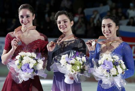 Figure Skating - ISU World Championships 2017 - Ladies Victory Ceremony - Helsinki, Finland - 31/3/17 - Gold medallist Evgenia Medvedeva (C) of Russia, silver medallist Kaetlyn Osmond (L) of Canada and bronze medallist Gabrielle Daleman of Canada attend the ceremony. REUTERS/Grigory Dukor
