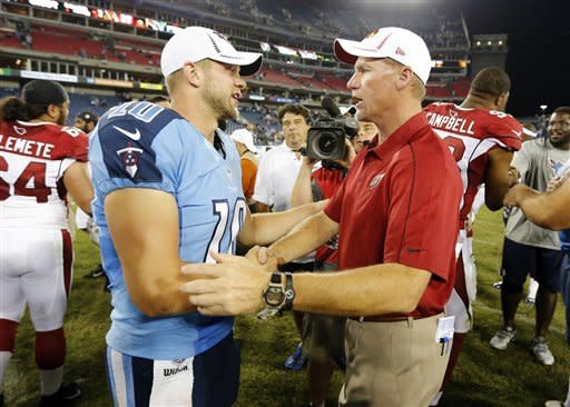 Tennessee Titans quarterback Jake Locker (10) is congratulated by Arizona Cardinals head coach Ken Whisenhunt after the Titans beat the Arizona Cardinals 32-27 in an NFL football preseason game on Thursday, Aug. 23, 2012, in Nashville, Tenn. Locker threw for 134 yards and two touchdowns in his home debut as the Titans' starting quarterback. (AP Photo/Joe Howell)
