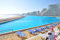 """<p>This pool is the largest pool in the world. The pool covers <a href=""""http://www.huffingtonpost.com/2012/05/21/worlds-largest-outdoor-pool_n_1532709.html#slide=more227662"""" class=""""link rapid-noclick-resp"""" rel=""""nofollow noopener"""" target=""""_blank"""" data-ylk=""""slk:20 acres"""">20 acres</a> and cost about <a href=""""http://www.slashgear.com/worlds-largest-swimming-pool-cost-nearly-two-billion-dollars-to-build-229828/"""" class=""""link rapid-noclick-resp"""" rel=""""nofollow noopener"""" target=""""_blank"""" data-ylk=""""slk:$2 billion"""">$2 billion</a> to construct.</p>"""
