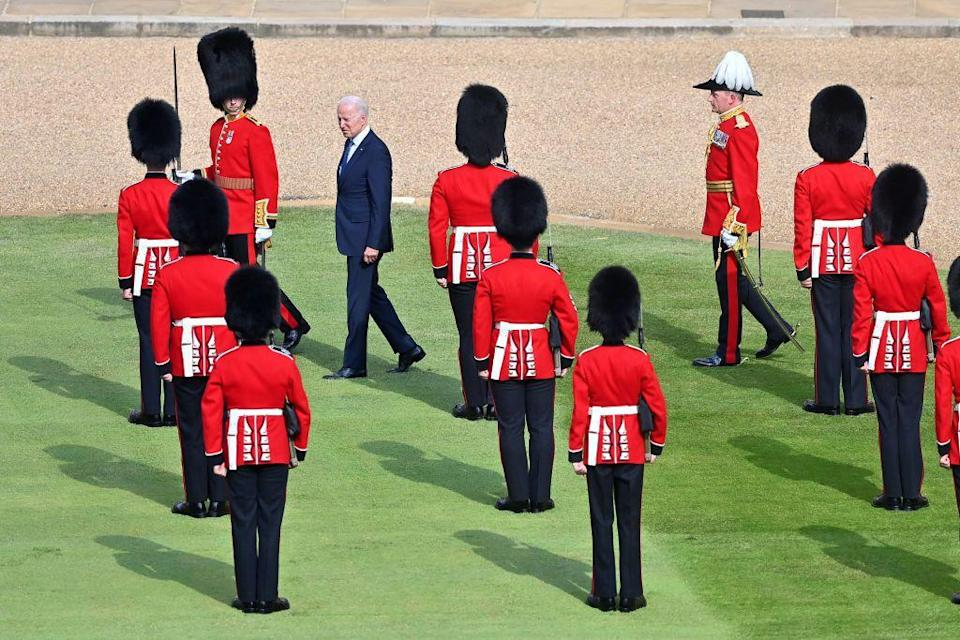 <p>Another view of Biden inspecting the guard of honour. </p>