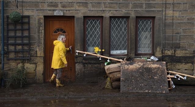 A clean-up mission is underway in Mytholmroyd after flooding deluged the village. (Oli Scarff/AFP via Getty Images)