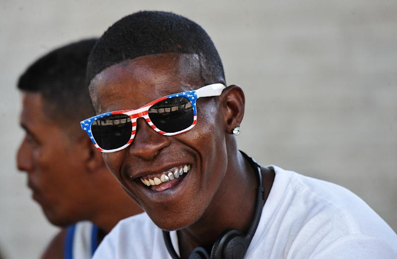 A young Cuban wearing sunglasses with a US flag design laughed as he spent time on a Havana street recently, just weeks before the island faces a generational change in leadership (AFP Photo/Yamil LAGE)