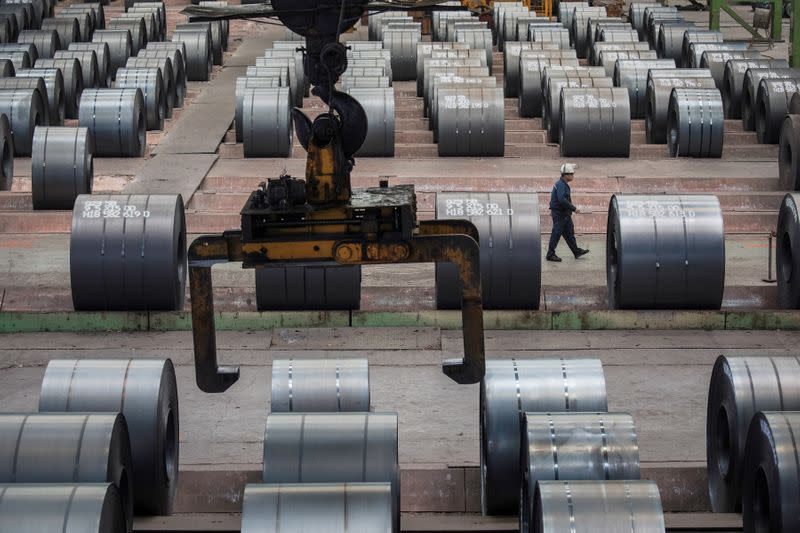 China's factory output perks up but consumers stay cautious
