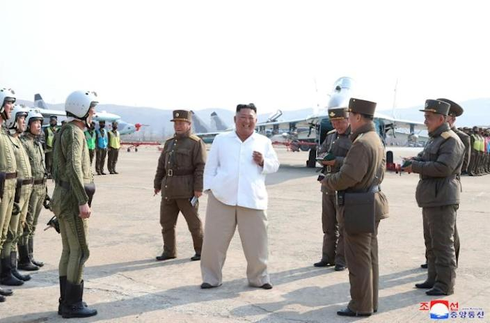 This undated picture released from North Korea's official Korean Central News Agency on April 12, 2020, shows North Korean leader Kim Jong Un inspecting military aircraft (AFP Photo/STR)