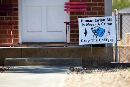 FILE PHOTO: A sign showing support is displayed in a neighborhood near the Evo A. DeConcini U.S. Courthouse, where humanitarian volunteer Scott Warren faces charges of harboring, and conspiracy to transport undocumented migrants in Tucson
