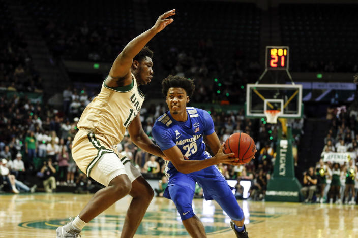 Memphis guard Jayden Hardaway (25) drives to the basket around UAB forward Will Butler (12) during the first half of an NCAA college basketball game Saturday, Dec. 7, 2019, in Birmingham, Ala. (AP Photo/Butch Dill)
