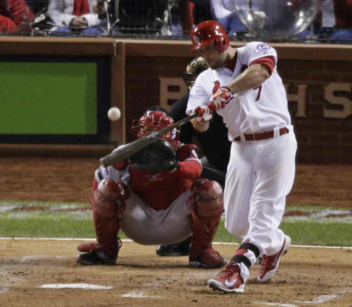 St. Louis Cardinals' Matt Holliday hits a home run during the fourth inning of Game 5 of baseball's World Series against the Boston Red Sox Monday, Oct. 28, 2013, in St. Louis. (AP Photo/Charlie Riedel)