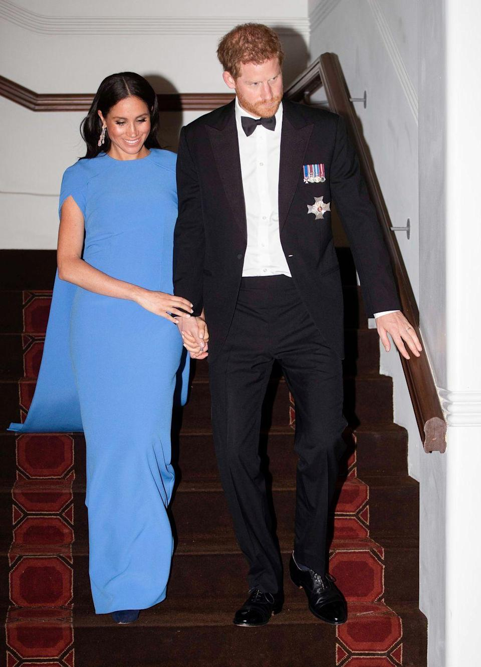 <p>Duchess Meghan was all smiles as she and Prince Harry arrived at the State Dinner with President Jioji Konrote. </p>