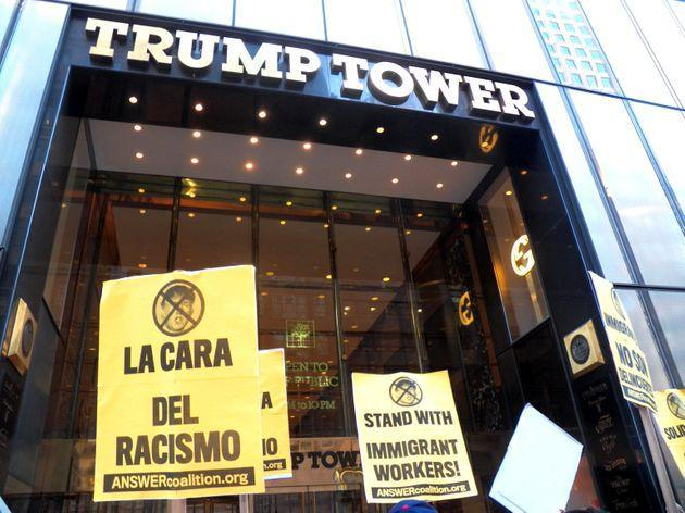 Signs expressing solidarity with immigrant workers on Sept. 16, 2015, during a protest against Donald Trump's anti-immigrant rhetoric. (Photo: Mark Apollo/Pacific Press via Getty Images)
