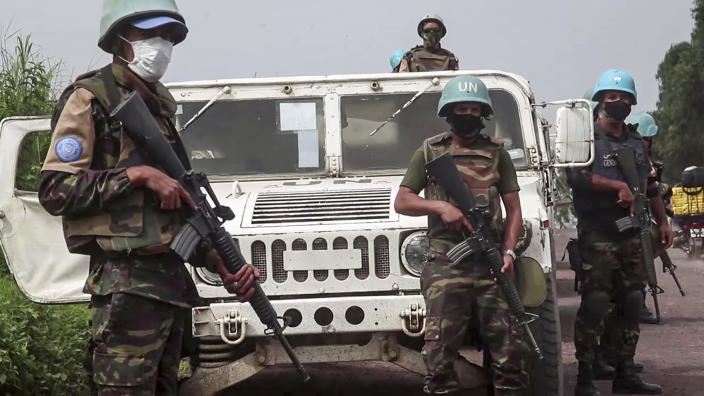 In this image taken from video, United Nations peacekeepers guard the area where a U.N. convoy was attacked and the Italian ambassador to Congo killed, in Nyiragongo, North Kivu province, Congo Monday, Feb. 22, 2021. The Italian ambassador to Congo Luca Attanasio, an Italian carabineri police officer and their Congolese driver were killed Monday in an attack on a U.N. convoy in an area that is home to myriad rebel groups, the Foreign Ministry and local people said. (AP Photo/Justin Kabumba)