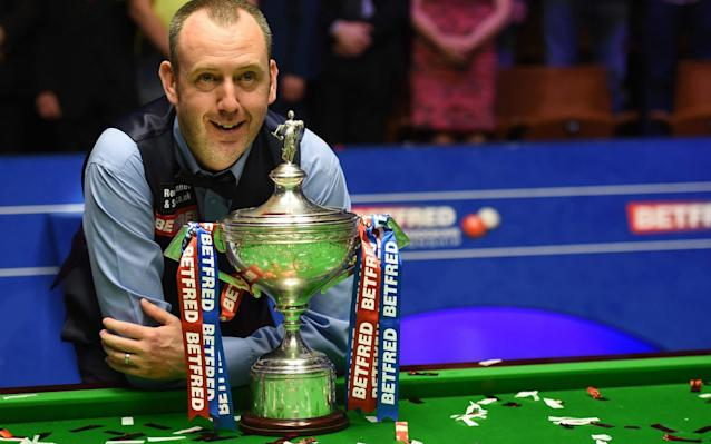 Mark Williams, 43, is the oldest champion since Ray Reardon lifted the trophy in 1978 - AFP