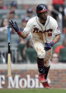 Atlanta Braves' Eddie Rosario drops his bat after hitting a two-run triple against the San Francisco Giants in the sixth inning of a baseball game Sunday, Aug. 29, 2021, in Atlanta. (AP Photo/Ben Margot)