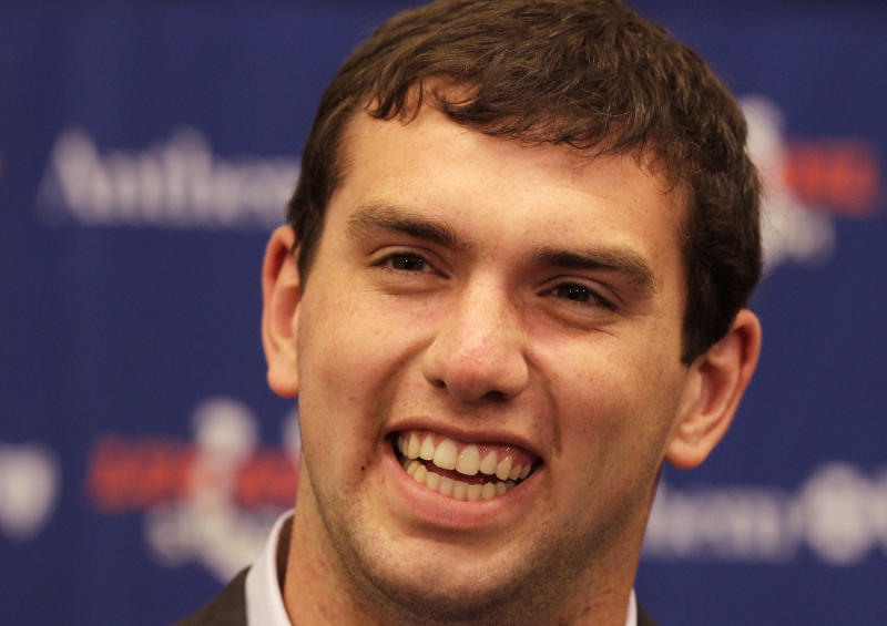 Quarterback Andrew Luck, the first pick of the NFL draft, laughs as he answers questions after he was introduced by the Indianapolis Colts NFL football team in Indianapolis, Friday, April 27, 2012. (AP Photo/Michael Conroy)