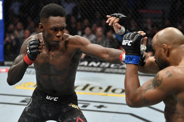 (L-R) Israel Adesanya of Nigeria battles Yoel Romero of Cuba in their UFC middleweight championship fight during the UFC 248 event at T-Mobile Arena on March 7, 2020 in Las Vegas. (Jeff Bottari/Zuffa LLC)
