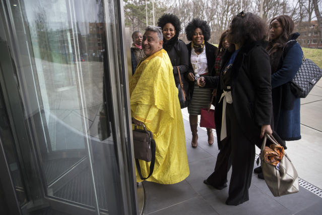 Supporters of former Ivory Coast President Laurent Gbagbo queue to the International Criminal Court in The Hague, Netherlands, Wednesday, Jan. 16, 2019, where lawyers were scheduled to discuss the next steps in the case of Gbagbo and ex-youth minister Charles Ble Goude, a day after both men were acquitted of crimes against humanity. (AP Photo/Peter Dejong)