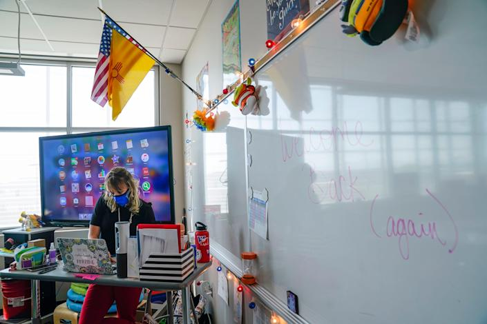 West Mesa High School teacher Stephanie Davy prepares for class on the second day of in-person instruction at West Mesa High School.