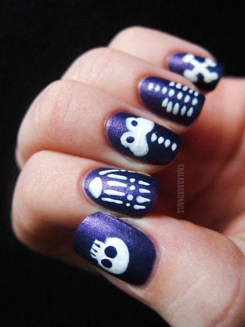 "<p>A skeleton manicure gets even scarier when you pop his body parts over dark purple polish. Go with matte black for more of a traditional look — or glow in the dark, if you want that extra boost of holiday spirit. </p><p><em><a href=""http://www.chalkboardnails.com/2011/10/skeleton-skittle.html"" rel=""nofollow noopener"" target=""_blank"" data-ylk=""slk:Get the tutorial at Chalkboard Nails »"" class=""link rapid-noclick-resp"">Get the tutorial at Chalkboard Nails »</a></em><br> </p>"