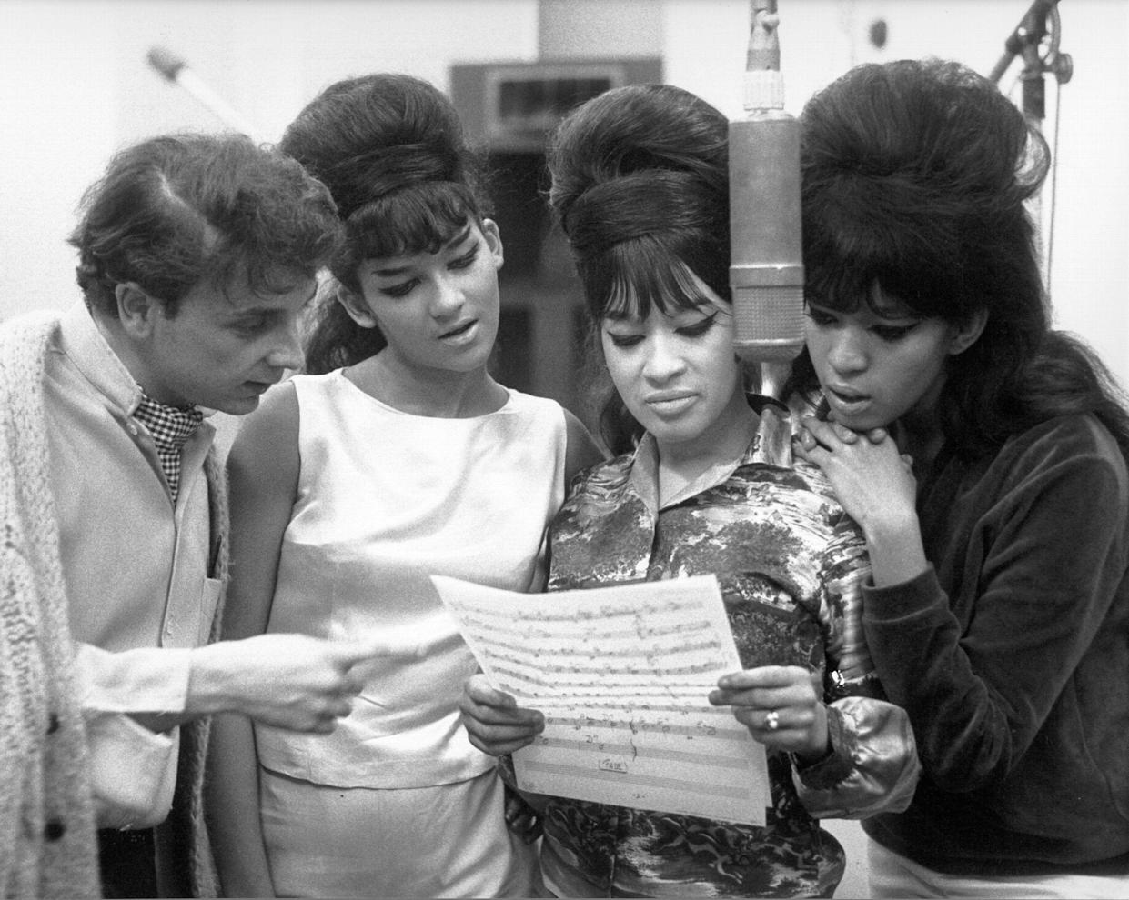 Phil Spector looked at sheet music with hit trio The Ronettes at Gold Star Studios in 1963. (Photo: Ray Avery via Getty Images)