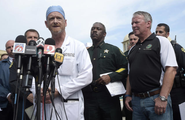 <p>Dr. Michael Cheatham, chief surgeon of the Orlando Health Regional Medical Center hospital, addresses reporters during a news conference after a shooting involving multiple fatalities at a nightclub in Orlando, Fla., Sunday, June 12, 2016. Watching are Orange County Sheriff Jerry Demings, second from right, and Orlando Mayor Buddy Dyer. (AP Photo/Phelan M. Ebenhack) </p>