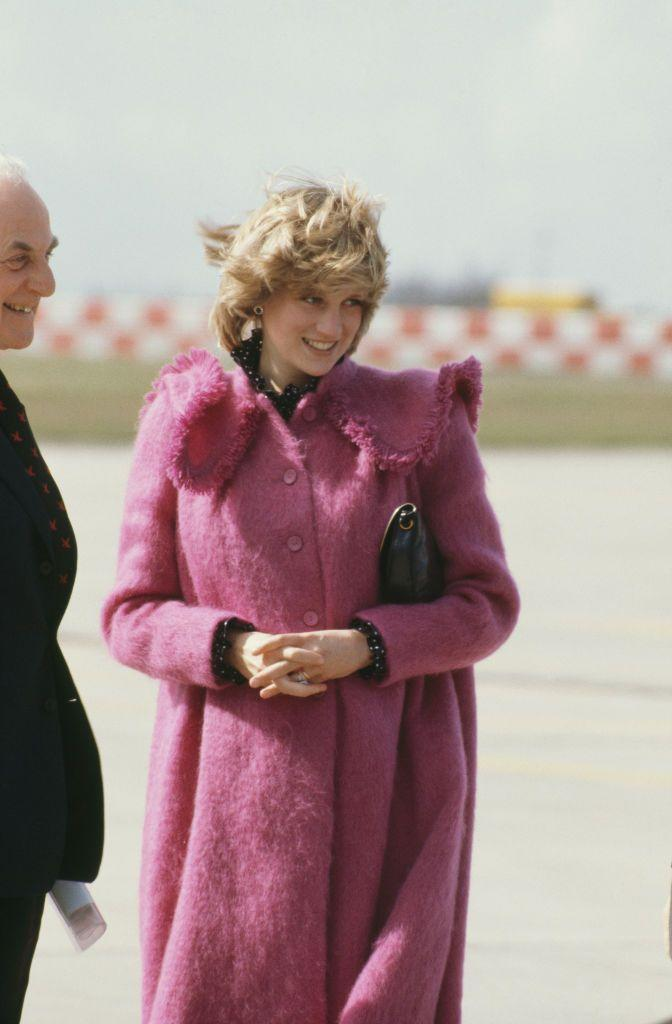 <p>Diana stepped out in an eye-catching pink coat by Bellville Sassoon, one of her favorite labels, to attend an event in Huddersfield in March 1982.</p>