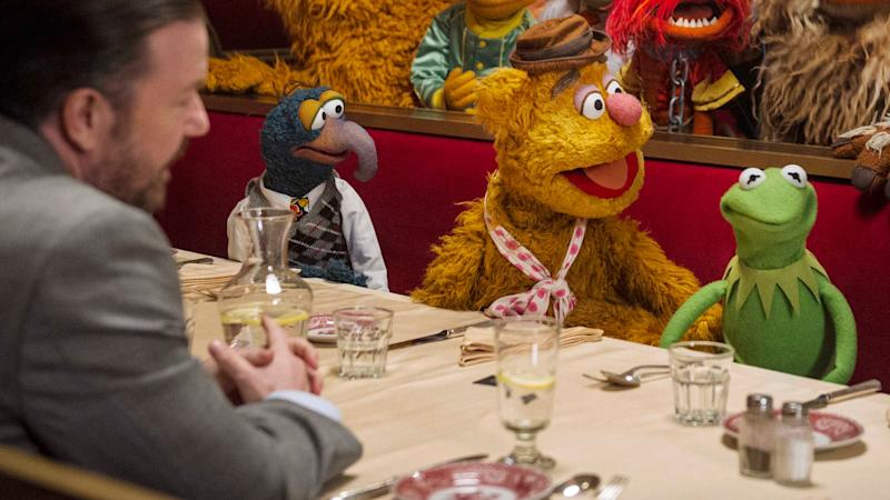 Ricky Gervais, Gonzo, Fozzie, and Kermit in 'Muppets Most Wanted' (Walt Disney Pictures)