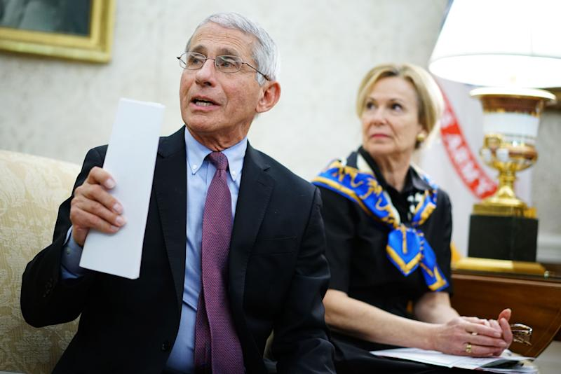 Dr. Anthony Fauci (L), director of the National Institute of Allergy and Infectious Diseases speaks next to Response coordinator for White House Coronavirus Task Force Deborah Birx, during a meeting with US President Donald Trump and Louisiana Governor John Bel Edwards D-LA in the Oval Office of the White House in Washington, DC on April 29, 2020. (Photo by MANDEL NGAN / AFP) (Photo by MANDEL NGAN/AFP via Getty Images)