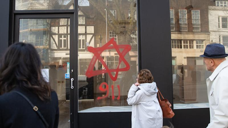 Anti-Semitic graffiti daubed on shop fronts condemned as 'senseless'