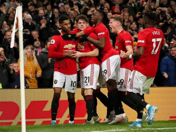 Manchester United celebrate during victory over Tottenham (Getty)