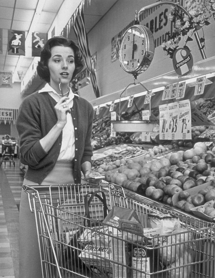 """<p>As competition grew, chains had to come up with ways to make their shopping experience stand out. Some stores did this was by including a <a href=""""https://clickamericana.com/topics/culture-and-lifestyle/scenes-from-grocery-stores-supermarkets-of-yesteryear"""" rel=""""nofollow noopener"""" target=""""_blank"""" data-ylk=""""slk:directory of items"""" class=""""link rapid-noclick-resp"""">directory of items</a> on the back of the cart. </p>"""