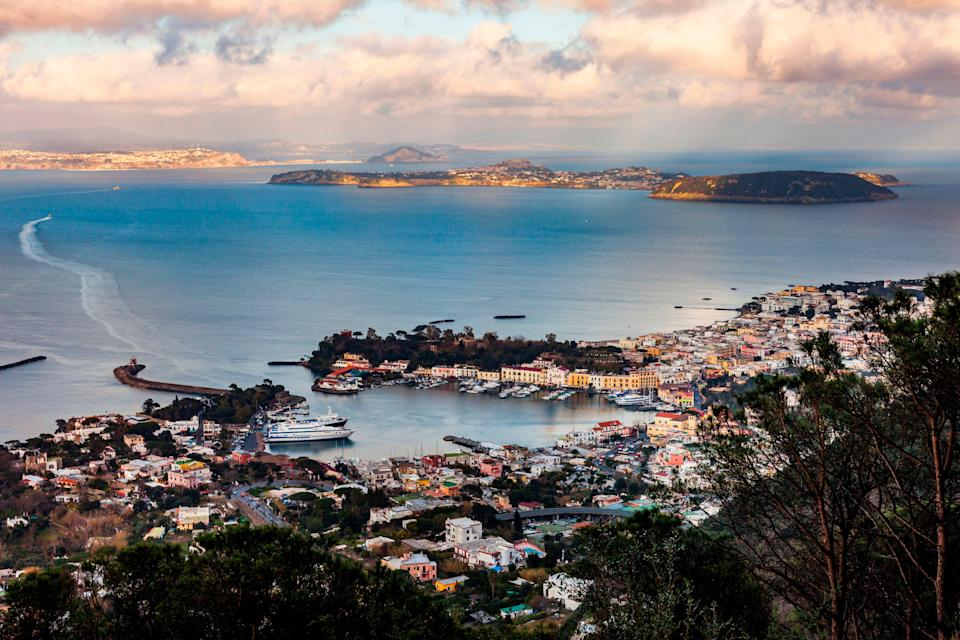 <p>The port of the volcanic island of Ischia (front) and the island of Procida (back) are pictured in the Bay of Naples</p> (AFP via Getty Images)