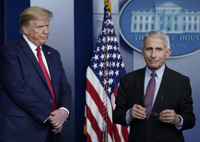 Dr. Anthony Fauci (R), director of the National Institute of Allergy and Infectious Diseases, and U.S. President Donald Trump participate in the daily coronavirus task force briefing at the White House on April 22, 2020 in Washington, DC. (Drew Angerer/Getty Images)