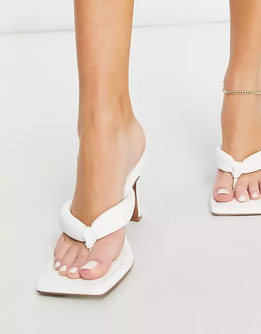 """<h2>Heeled Flip-Flops</h2><br>""""We have seen a great reaction to heeled-toe thong sandals this year so far. <a href=""""https://eur01.safelinks.protection.outlook.com/?url=https%3A%2F%2Fwww.asos.com%2Fus%2Fsearch%2F%3Fcurrentpricerange%3D35-40%26q%3Dasos%2520haven%26sort%3Dfreshness&data=04%7C01%7Cjes.feuer%40asos.com%7C8246e651f9f945a8545908d92b6d5a33%7C4af8322c80ee4819a9ce863d5afbea1c%7C0%7C0%7C637588570928914158%7CUnknown%7CTWFpbGZsb3d8eyJWIjoiMC4wLjAwMDAiLCJQIjoiV2luMzIiLCJBTiI6Ik1haWwiLCJXVCI6Mn0%3D%7C1000&sdata=umE65SoyI%2F%2B5wycJq6o54CiXWCr1xl5PnhOpoliKHNs%3D&reserved=0"""" rel=""""nofollow noopener"""" target=""""_blank"""" data-ylk=""""slk:ASOS DESIGN Haven"""" class=""""link rapid-noclick-resp"""">ASOS DESIGN Haven</a> has sold phenomenal units and often sell out immediately [upon release]! We have dropped lots of colors already this season including lilac toweling and neon — the most popular color being all-white which is perfect for summer.""""<br><br>- Vanessa Spence, Commercial Design & Visual Director at ASOS<br><br><strong>ASOS DESIGN</strong> Haven Padded Toe Thong Heeled Sandals In White, $, available at <a href=""""https://go.skimresources.com/?id=30283X879131&url=https%3A%2F%2Fwww.asos.com%2Fus%2Fasos-design%2Fasos-design-haven-padded-toe-thong-heeled-sandals-in-white%2Fprd%2F21813337%3Fcolourwayid%3D60301406"""" rel=""""nofollow noopener"""" target=""""_blank"""" data-ylk=""""slk:ASOS"""" class=""""link rapid-noclick-resp"""">ASOS</a>"""