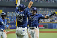 Tampa Bay Rays' Wander Franco celebrates his three-run home run off Boston Red Sox starting pitcher Eduardo Rodriguez with Kevin Kiermaier (39) during the fifth inning of a baseball game Tuesday, June 22, 2021, in St. Petersburg, Fla. (AP Photo/Chris O'Meara)
