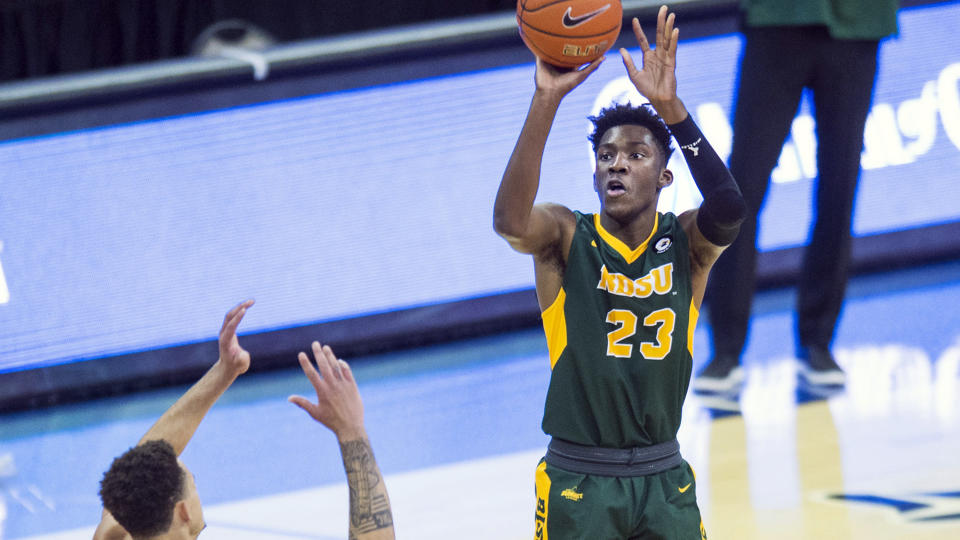North Dakota State's Maleeck Harden-Hayes scores against Creighton during the first half of an NCAA college basketball game in Omaha, Neb., Sunday, Nov. 29, 2020. (AP Photo/Kayla Wolf)