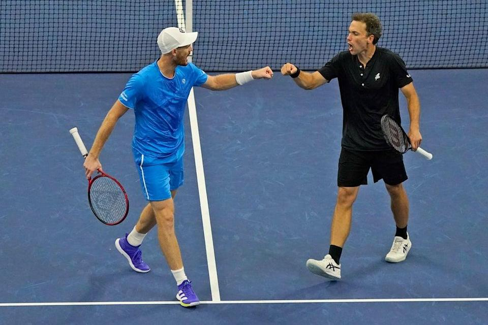 Jamie Murray, left, and Bruno Soares are into the US Open men's doubles final (Seth Wenig/AP/PA) (AP)