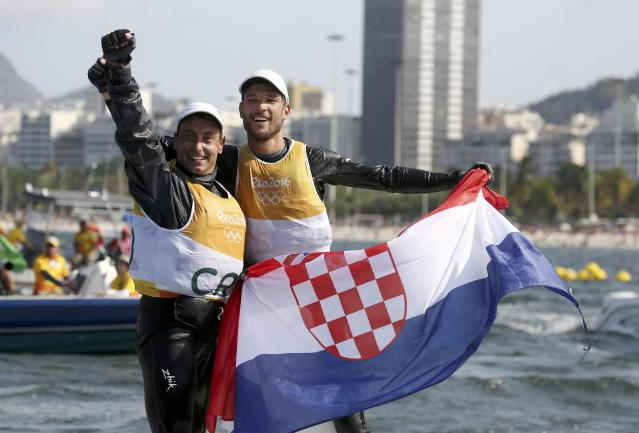 2016 Rio Olympics - Sailing - Final - Men's Two Person Dinghy - 470 - Medal Race - Marina de Gloria-Rio de Janeiro, Brazil - 18/08/2016. Sime Fantela (CRO) of Croatia and Igor Marenic (CRO) of Croatia celebrate gold medal. REUTERS/Benoit Tessier FOR EDITORIAL USE ONLY. NOT FOR SALE FOR MARKETING OR ADVERTISING CAMPAIGNS.
