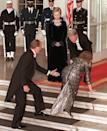 <p>Queen Sofia of Spain trips up the stairs of the White House upon arriving for a state dinner. President Bill Clinton reaches to help as First Lady Hillary Clinton looks on. Pesky steps. </p>