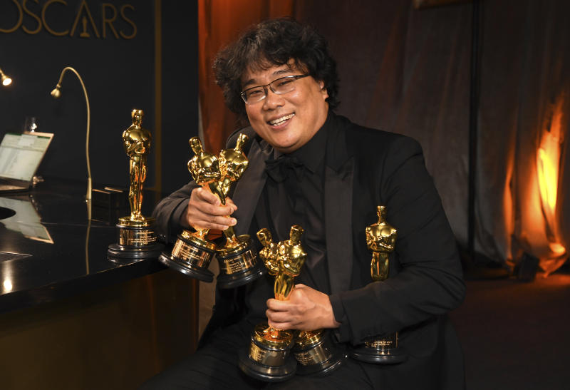 "Bong Joon-ho holds the Oscars for best original screenplay, best international feature film, best directing, and best picture for ""Parasite"" at the Governors Ball after the Oscars on Sunday, Feb. 9, 2020, at the Dolby Theatre in Los Angeles. (Photo by Richard Shotwell/Invision/AP)"